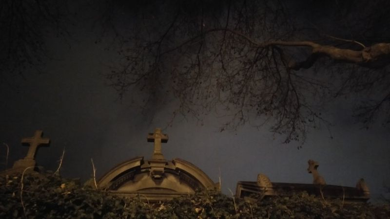 The Cemetery. · Paris France Cemetery Photography Graves Gravestone Cross Trees Behind The Wall Moon Light Lighting Night Lights Night Sky Night Photography Darkness Eery Spooky Unedited Unfiltered