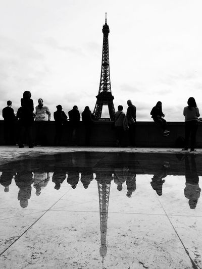 Tourists looking at eiffel tower