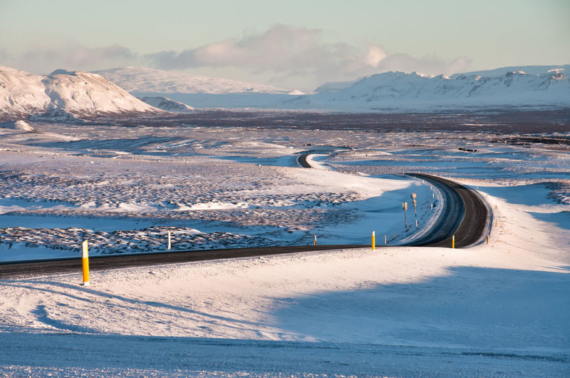 Snow covered winter landscape in Iceland Daytime Iceland Panorama Road Snow ❄ Sunlight Sunny Travel Beauty In Nature Cold Cold Temperature Covering Day Destination Icelandic Island Journey Mountain Outdoors Scenics - Nature Snow Tourism Tranquil Scene Tranquility Winter