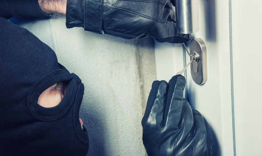 burglar holding Lock-picker to open a housedoor Alarm System Home Security Theft Alarm Apartment Break Burglary Closed Criminal Gangster House Intruder  Key Lock Lock Picking Lockpicking Masked Protection Robber Robbery Safety Thief Time Vandalism