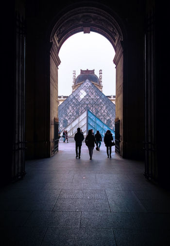 Louvre museum Architecture Museum Tourism People Silhouette Building Exterior The Architect - 2017 EyeEm Awards MaterialDesign Architectural Column Arch ExploreEurope Louvremuseum Louvre, France Louvrepyramid Louvre Paris Framed View Framed Photograph