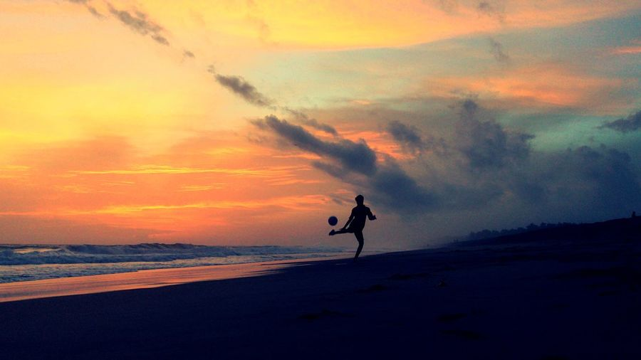 Dont miss the football on beach. Football Sand Sunset Sky Cloud - Sky Sea Beach Water Land Real People Silhouette Lifestyles Leisure Activity