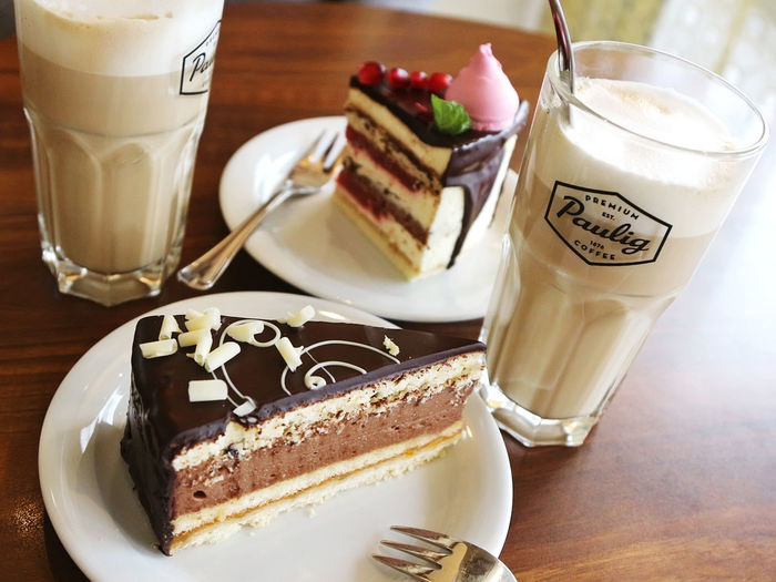 Close-up of cake with coffee served on table