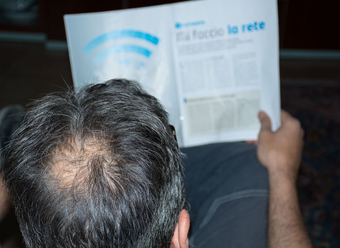 High angle view of man reading document