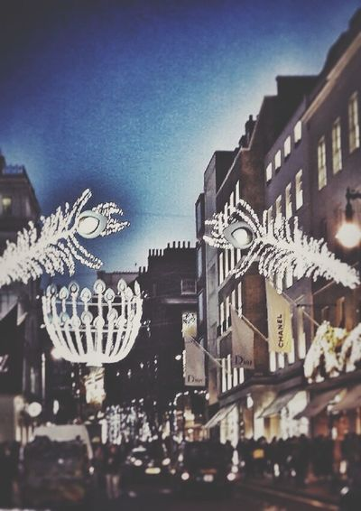 More London illuminations Christmastime Building Exterior Architecture Built Structure Sky Day City Low Angle View Outdoors Text No People Shops City Life Lifestyles Illuminated Lookup EyeEm Best Edits Skyporn Fairy Lights London Lifestyle Peacock Feathers