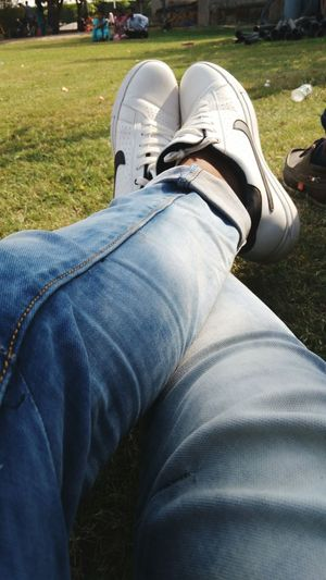 Shoe One Person Personal Perspective Outdoors Lifestyles Relaxation Jeans Leisure Activity Men Grass People SneakerFreaks