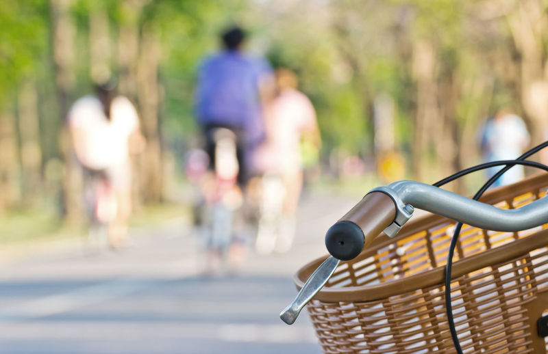 Close-up of woman with bicycle on street
