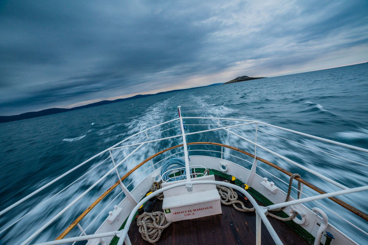 Traveling by boat at dawn in Croatian islands from Lošinj to Susak Bad Weather Blue Sky Boat Cloud Cloud - Sky Cloudy Croatia Horizon Over Water Landscapes With WhiteWallMode Of Transport Morning Morning Light Morning Sky Nature Nautical Vessel No People Scenics Sea The Great Outdoors - 2016 EyeEm AwardsTransportation Need For SpeedTraveling Water Winter Photography In Motion