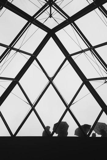 Rainy Day Tourist Tourism Paris Paris Parisfrance France Monochrome Blackandwhite Umbrella Rainy Days Louvre Streets Pyramide Du Louvre Pyramid Streetphotography Politics And Government City Clear Sky Triangle Visiting