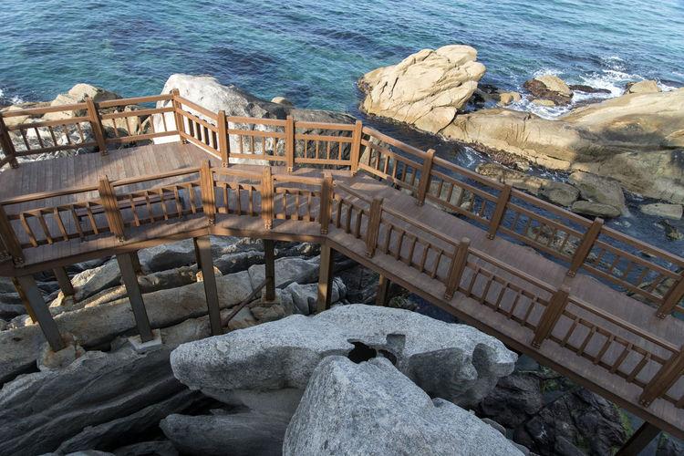 rocky coast near Jumunjin Port, Gangreung, Gangwondo, South Korea Beach Beauty In Nature Day High Angle View Horizon Over Water Nature No People Outdoors Railing Rock - Object Rocks Rocky Coast Sea Seaside Stairway Water Wave