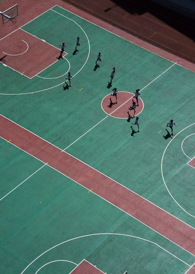 High angle view of people playing basketball court