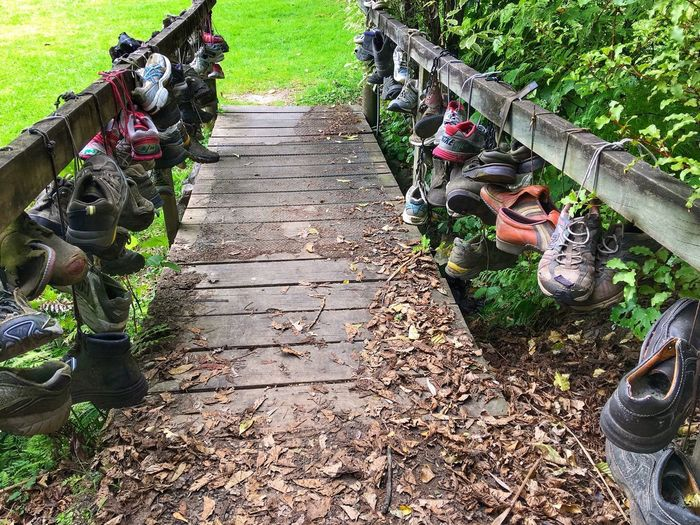 Shoe bridge Bridge Tradition Traveller Shoes Day Outdoors Teamwork Nature Men People