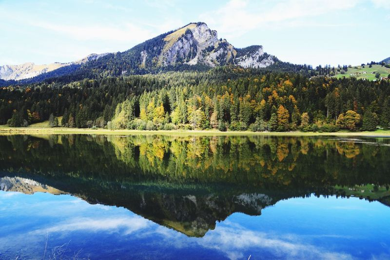 Reflection Water Sky Lake Tranquility Beauty In Nature Nature Tree Scenics - Nature Symmetry Mountain Travel Destinations