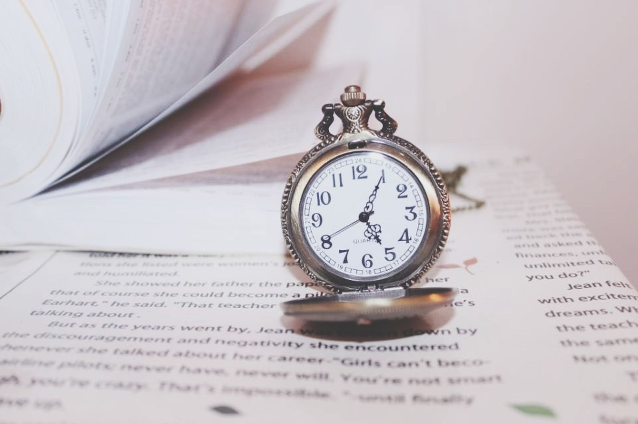 indoors, time, clock, number, communication, text, clock face, close-up, old-fashioned, accuracy, retro styled, instrument of time, still life, single object, minute hand, wall clock, table, antique, western script, wealth