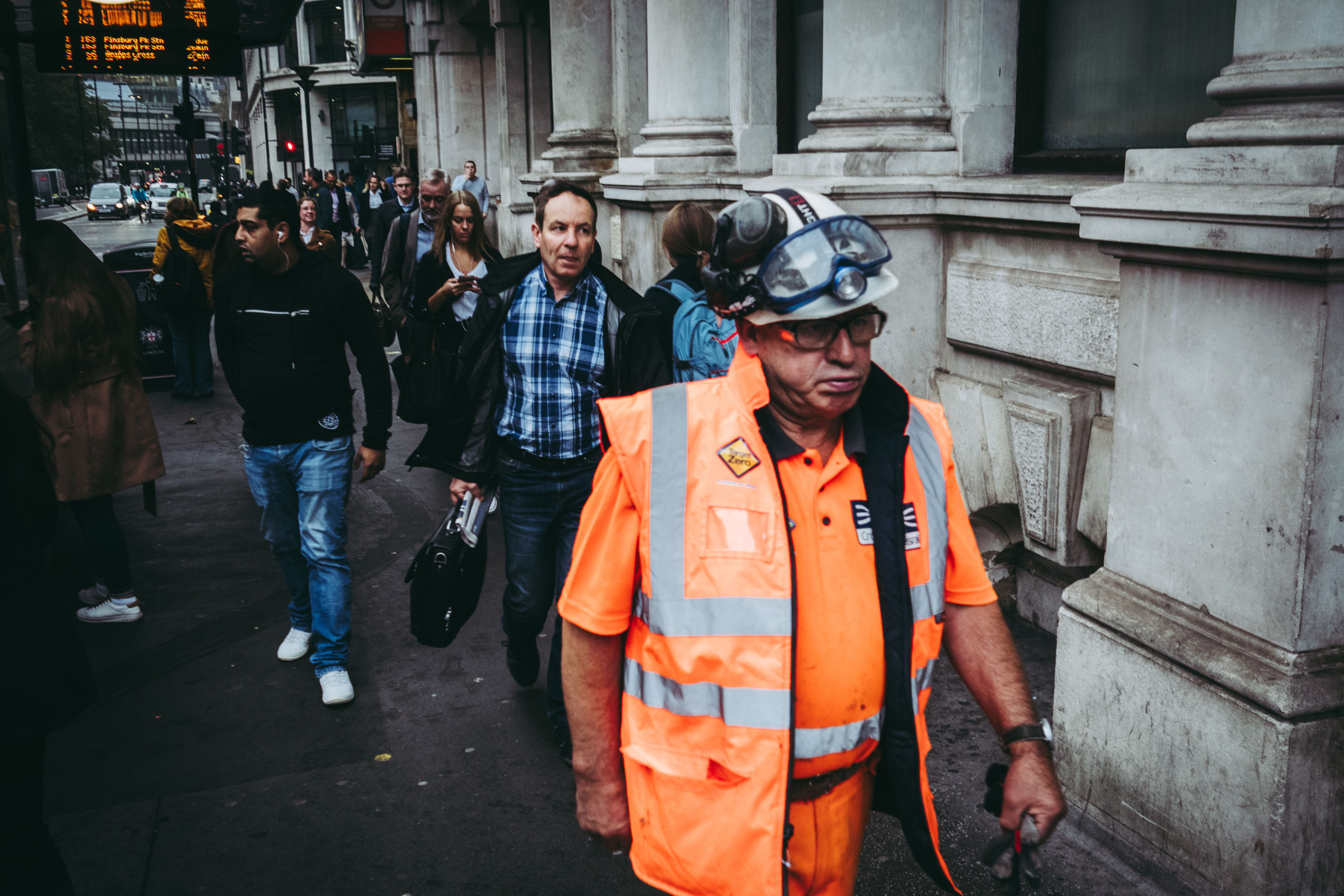 group of people, real people, architecture, men, safety, occupation, street, city, standing, protection, headwear, building exterior, helmet, built structure, day, clothing, women, people, reflective clothing, adult, coworker