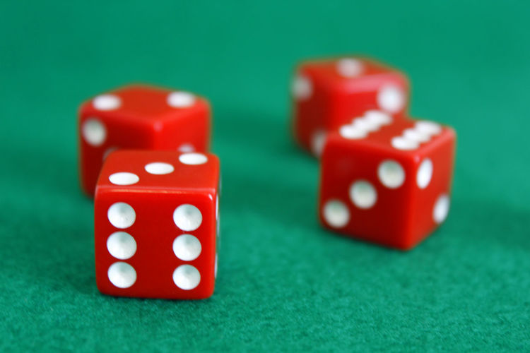 Close-Up Of Red Dice On Green Table