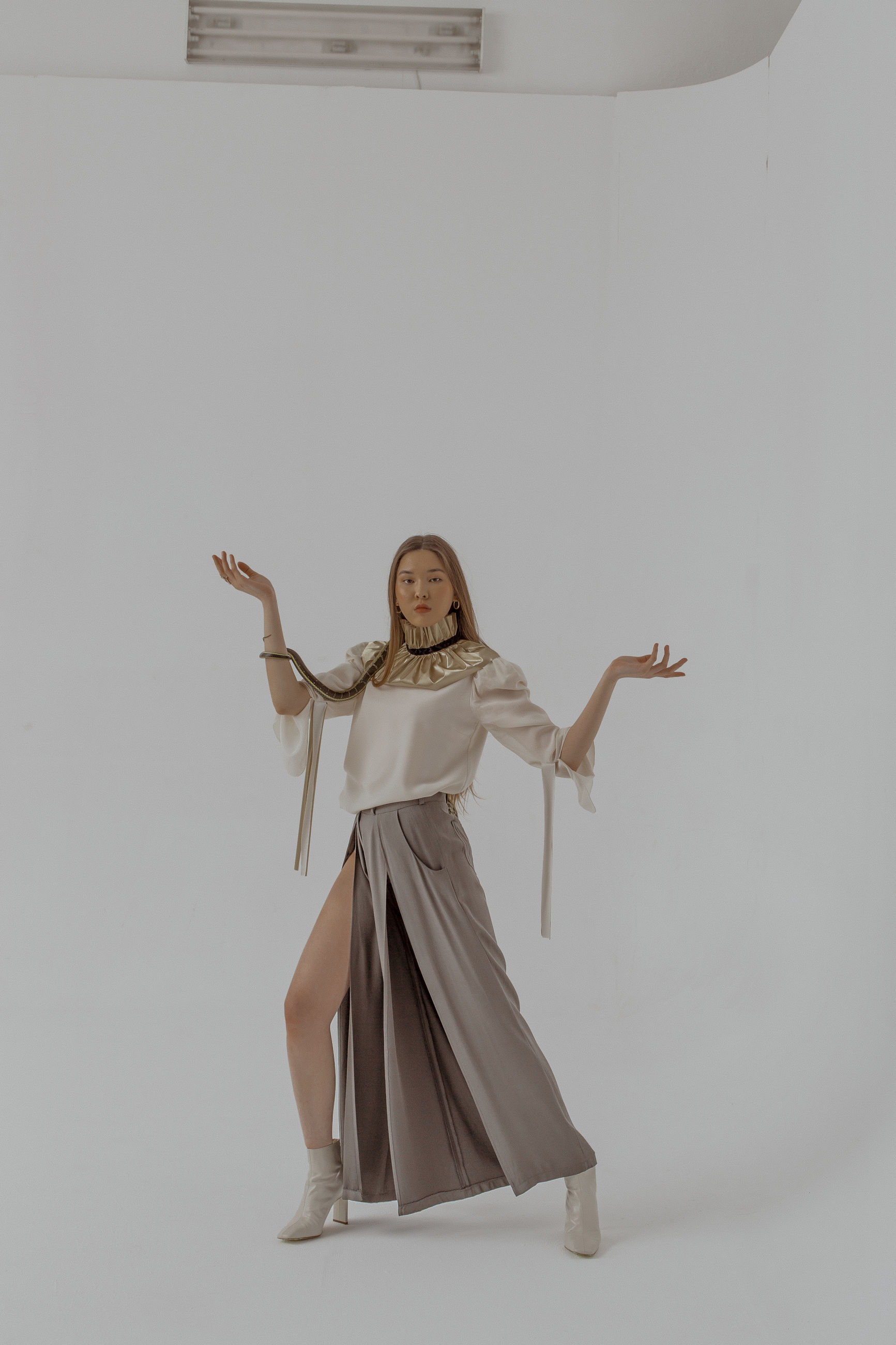 one person, indoors, human arm, full length, studio shot, front view, standing, young adult, dancing, lifestyles, women, beauty, cut out, looking, portrait, smiling, looking at camera, limb, beautiful woman, arms raised