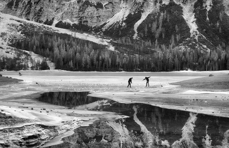 https://en.wikipedia.org/wiki/Pragser_Wildsee Black And White Photography Human Presence Ice Lago Di Braies (Pragser Wildsee) Lake Mountains Reflections Trentino Alto Adige