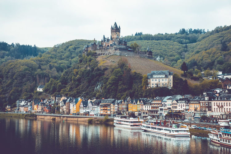 View to the city and castle of Cochem over the river Mosel, Rheinland-Pfalz, 3rd May of 2019. Germany Mosel Building Exterior Architecture Built Structure Water Building Sky City Nature Nautical Vessel Transportation Day Mode Of Transportation No People Outdoors Cochem Cochem An Der Mosel Cochem Castle Waterfront River Plant Tree Travel Destinations TOWNSCAPE Tower