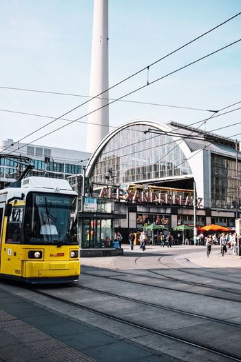 Tram On Road Against Built Structures