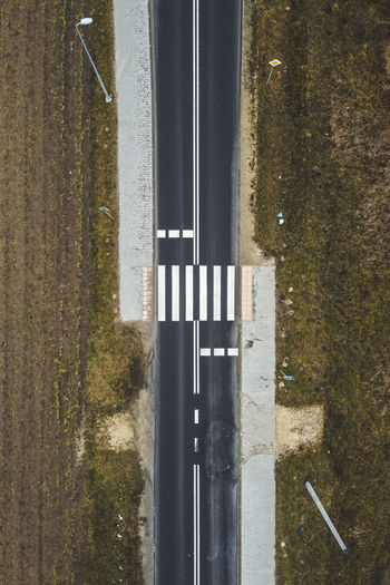 High angle view of reflection on road in puddle