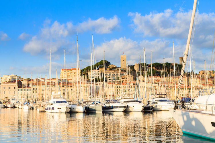 Cannes port view, France Water Nautical Vessel Mode Of Transportation Transportation Sky Waterfront No People Yacht Sailboat Outdoors Nature Moored Cloud - Sky Cannes Cannes, France France France Photos Landmark Boat Harbour Harbour View Port
