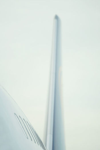 Low angle view of airplane wing against clear sky