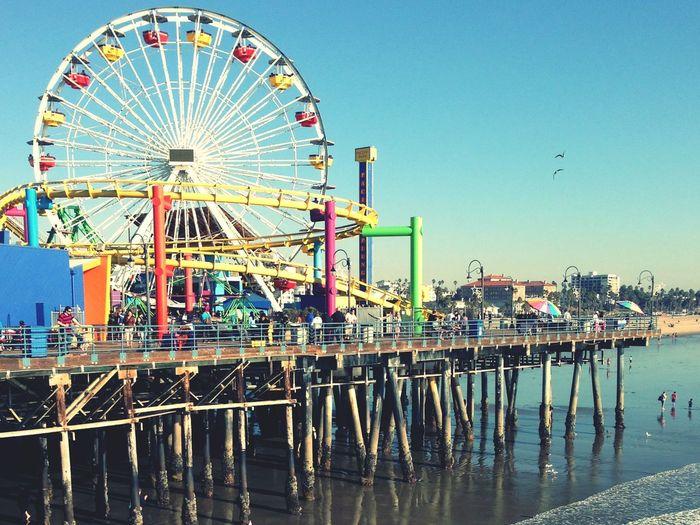 Amusement Rides On Santa Monica Pier Against Sky