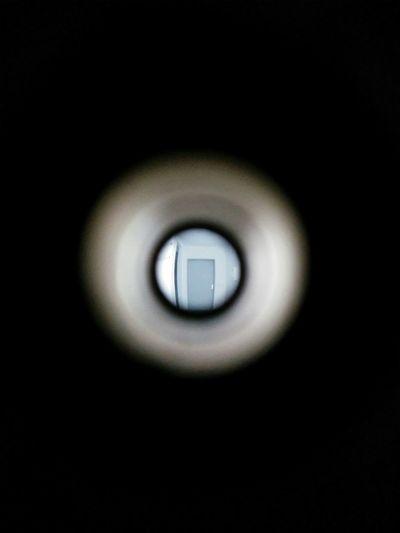 Black Background Circle Close-up Dark Geometric Shape Illuminated Indoors  No People Peep Hole Single Object