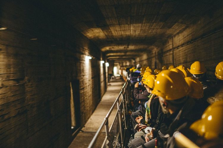 Manual workers working in subway train