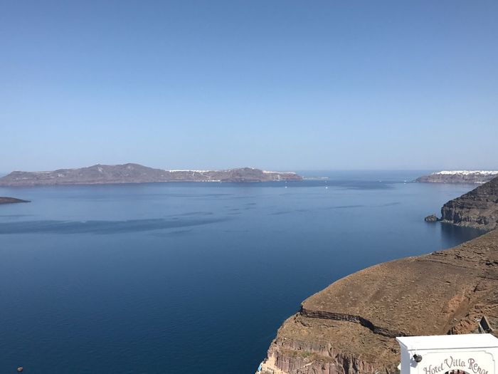 Santorini, Greece View From The Top Viewfromthetop Greek Islands Nowind #nature_collection #EyeEmNaturelover #nature Peace And Quiet Travel Destinations EyeEm Selects Water Sea Sky Beauty In Nature Tranquility Scenics - Nature Tranquil Scene Nature Clear Sky Day Blue Rock Solid No People Idyllic Outdoors Beach Land
