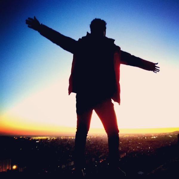 top Silhouette Sunset Arms Outstretched One Man Only Sky Adults Only Adult One Person Rear View Standing Men Cityscape City Clear Sky Outdoors