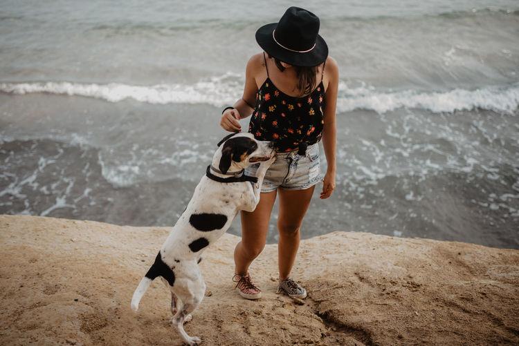 Man with dog on beach