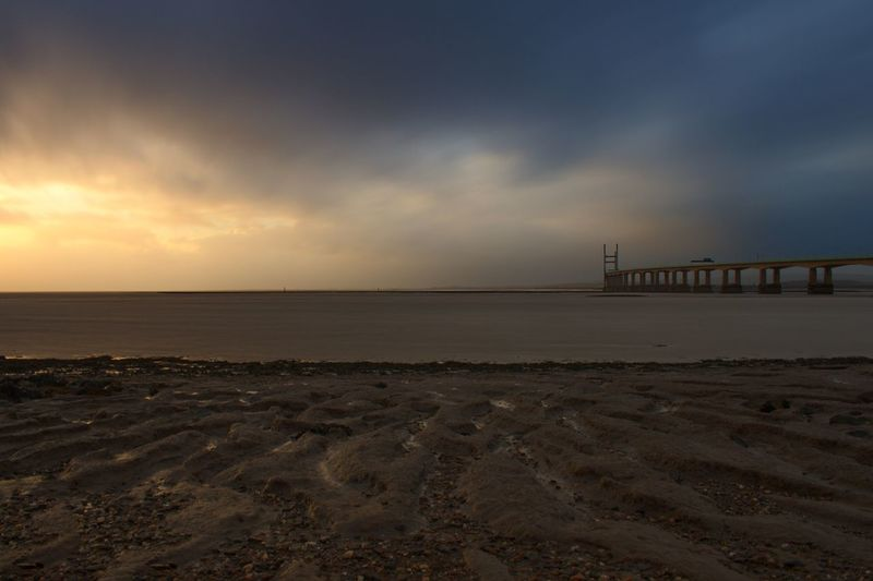 Stormy Weather Long Exposure Storm Cloud Sky Sunset Cloud - Sky Nature Sea Water Beach Tranquility Scenics Tranquil Scene Horizon Over Water Outdoors Beauty In Nature Sand No People Bridge - Man Made Structure Architecture Built Structure