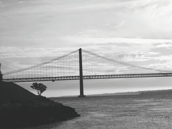 Connection Bridge - Man Made Structure Built Structure Architecture Suspension Bridge Engineering Water Famous Place Travel Destinations Transportation International Landmark Tourism Travel Sky Waterfront Sea San Francisco Bay Cloud - Sky Outdoors Nature Black And White Black And White Photography Black&white Monochrome Photography EyeEm Best Shots