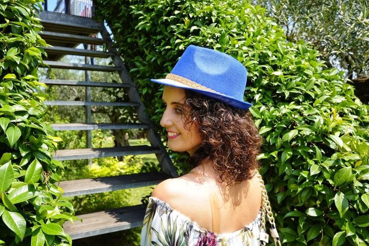 Adult Beautiful Woman Curly Hair Day Fashion Green Color Growth Hair Hairstyle Hat Leisure Activity Lifestyles Nature One Person Outdoors Plant Portrait Real People Standing Women Young Adult Young Women