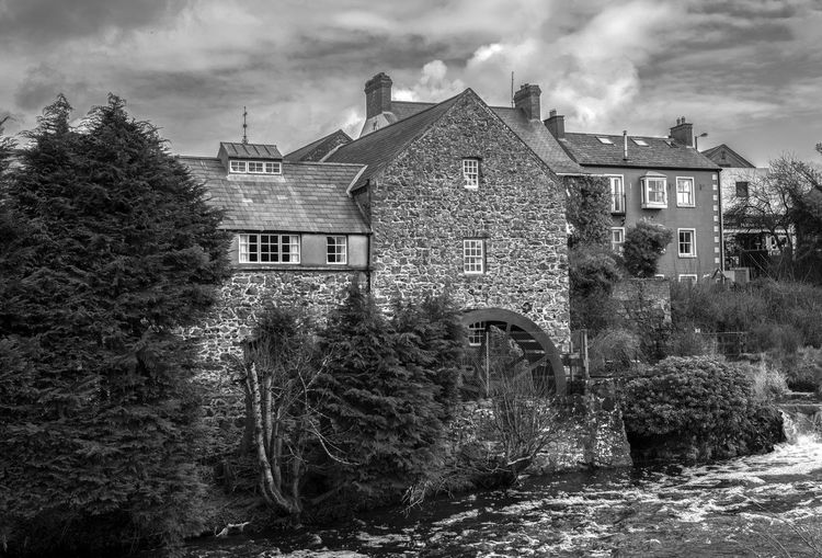 Restored Mill in Bushmills Architecture Building Exterior Built Structure Day House No People Old Mill Restored Outdoors Rural Scene Sky Tree Water Powered Mill First Eyeem Photo