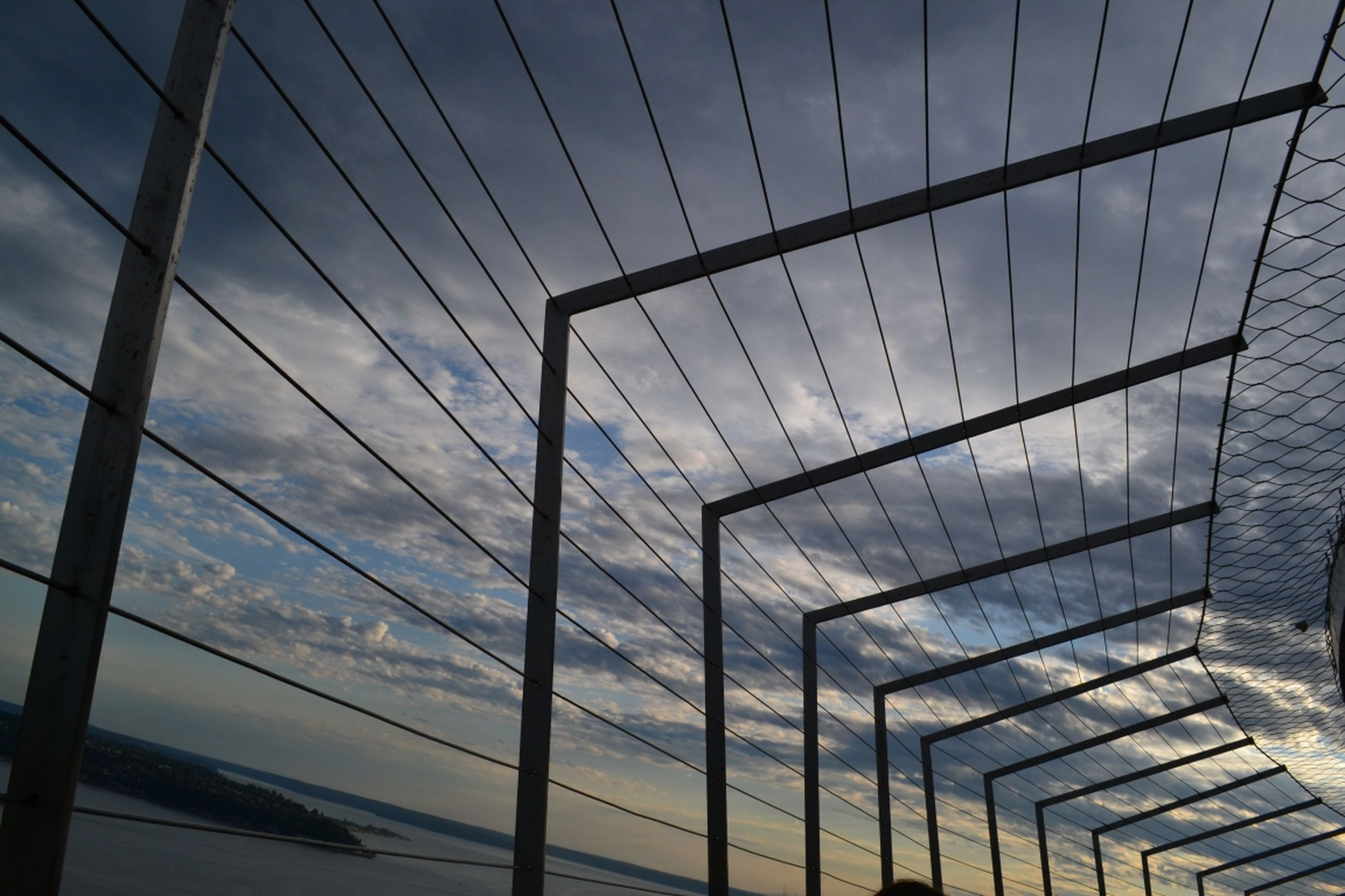 built structure, architecture, sky, connection, reflection, water, low angle view, cloud - sky, day, glass - material, indoors, no people, modern, bridge - man made structure, railing, sea, cloud, building exterior, transportation