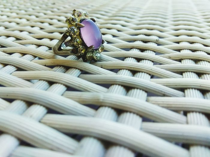 Close-up of ring on wicker table