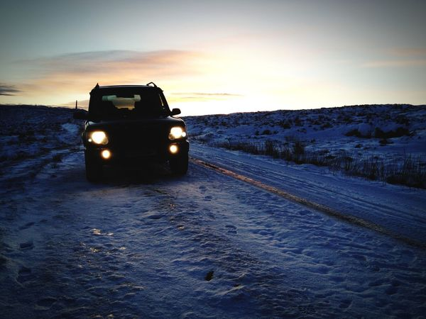 Snowy sunset Land Rover Snow Winter Sunset Transportation Sunset 4x4 Road Outdoors