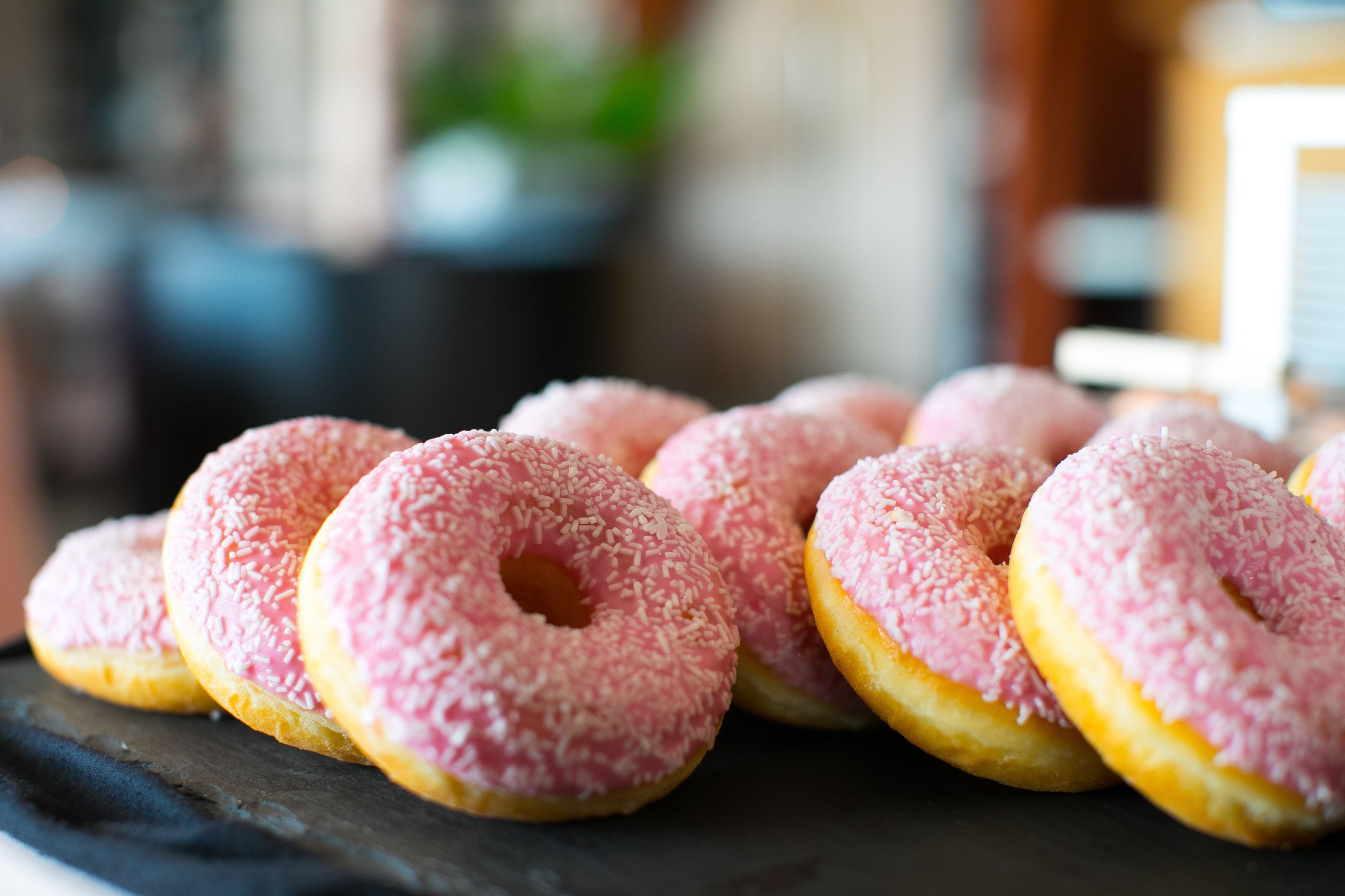 food, food and drink, freshness, sweet food, still life, close-up, no people, indulgence, focus on foreground, dessert, sweet, temptation, ready-to-eat, table, indoors, baked, unhealthy eating, donut, pink color, fruit, macaroon, tray, snack