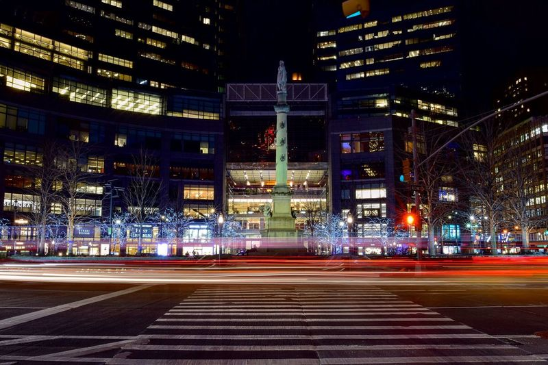 Light trails at columbus circle in city