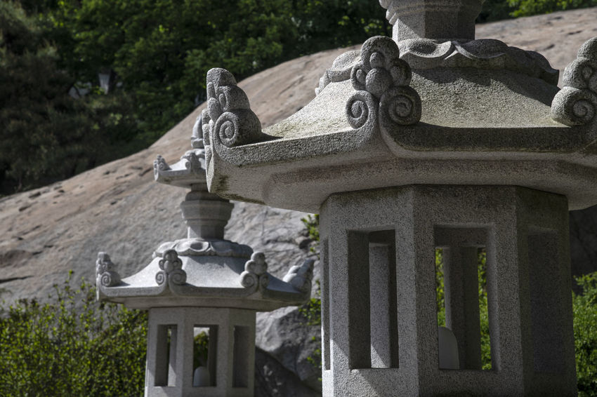 view at Bomunsa, a famous Buddhism temple in Seokmodo, Kimpo, Gyeonggido, South Korea Architecture Bomunsa Buddhism Temple Seokmodo South Korea Architecture Art And Craft Belief Buddhism Built Structure Cemetery Day Focus On Foreground Grave Nature No People Outdoors Plant Religion Religious  Representation Sculpture Solid Spirituality Statue Stone Stone Material Temple Tombstone