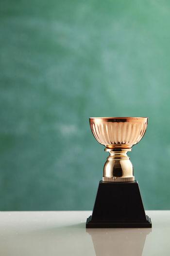 Trophy against blackboard on table