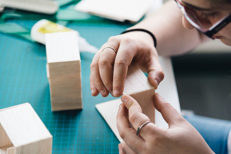 YOung woman architect working with models Architecture_collection Student Woman Working Workshop Architecture Model Architecture Student Childhood Close-up Day Human Hand Indoors  Model Model Workshop Real People Wooden Model Young Adult