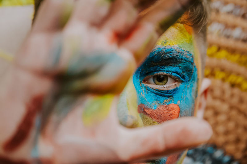 Close-up of boy with face paint gesturing outdoors