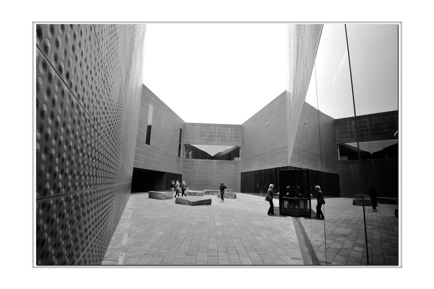 All About Angles 6 DeYoung Museum San Francisco CA🇺🇸 Golden Gate Park Bnw_friday_eyeemchallenge Museum Time Fine Arts Museum Entry Courtyard Entrance Architecture Architectural Detail Façade Perforated & Dimpled Copper Plates Stone Tiles Monochrome_Photography Monochrome Black & White Black & White Photography Black And White Black And White Photography Drawn Stones Seating 1st Museum Built 1895 Severely Damaged 1989 Loma Prieta Earthquake New Museum Opened 2005 Architecture_collection