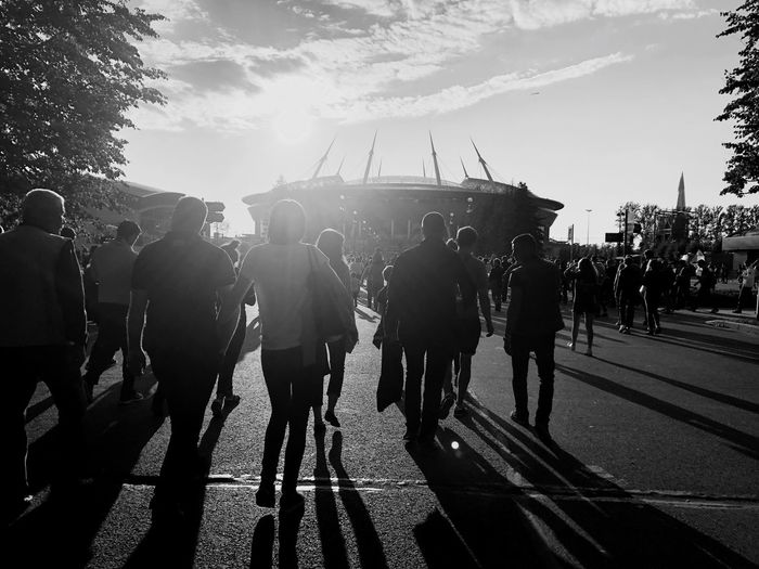 """The stadium """"St. Petersburg"""" 02.09.2018 People going to the stadium. Saint Petersburg People Stadium Spartacus Zénith  Is Sold Out The Stadium St. Petersburg Saint Petersburg Group Of People Crowd Large Group Of People Real People Sky Men Nature City Street Lifestyles Day Sunlight Walking Outdoors Architecture Road #urbanana: The Urban Playground"""