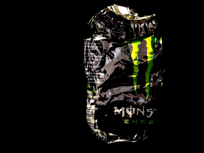 Monster Crumpled Food And Drink Monster Aluminium Can Black Background Black Color Close-up Copy Space Creativity Design Indoors  Monster Energy Nature No People Pattern Reflection Representation Single Object Studio Shot Text Western Script