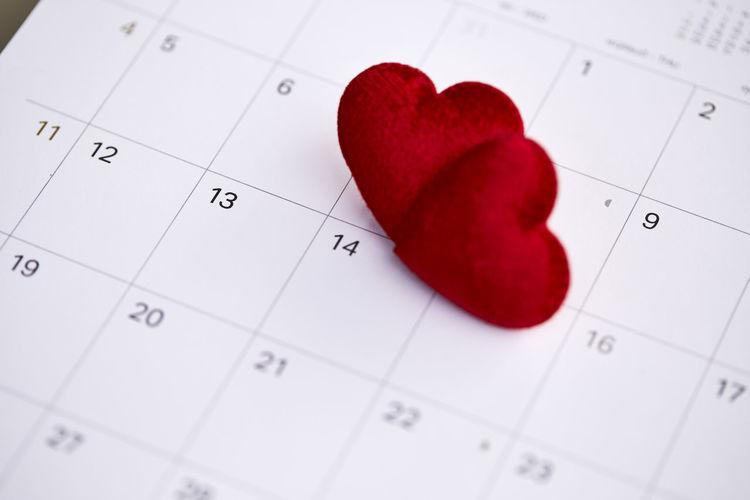 High angle view of heart shape on calendar